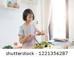 asian little girl cooks in the...   Shutterstock . vector #1221356287