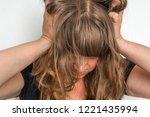 depressed woman with hands in... | Shutterstock . vector #1221435994
