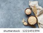 rolled oats  oat flakes  whole... | Shutterstock . vector #1221451594