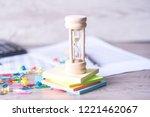 classic wooden hourglass or...   Shutterstock . vector #1221462067