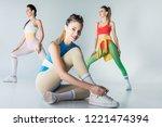 attractive sporty girl tying... | Shutterstock . vector #1221474394