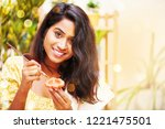 woman decorating diya for... | Shutterstock . vector #1221475501