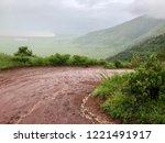 wet curvy seneto descent road ... | Shutterstock . vector #1221491917