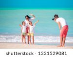 man taking a photo of his family   Shutterstock . vector #1221529081
