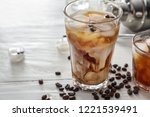 glasses with cold coffee on... | Shutterstock . vector #1221539491