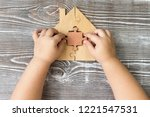 puzzle in the hands of a child  ... | Shutterstock . vector #1221547531