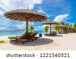 wooden sunbed and umbrella on...   Shutterstock . vector #1221560521