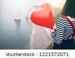 happy girl with a red balloon... | Shutterstock . vector #1221572071