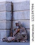 ragged beggar begging on the... | Shutterstock . vector #1221597994