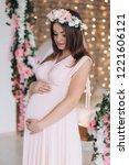 charming brunette pregnant... | Shutterstock . vector #1221606121