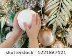 children's hands holding a...   Shutterstock . vector #1221867121