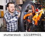 young male mounts bicycle parts ... | Shutterstock . vector #1221899431