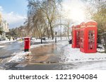 red phone boxes in london with... | Shutterstock . vector #1221904084