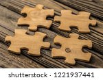 placing a piece of the puzzle... | Shutterstock . vector #1221937441