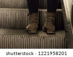 foot  wearing old boots ... | Shutterstock . vector #1221958201