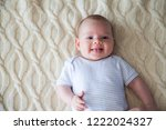 happy baby in striped bodysuit... | Shutterstock . vector #1222024327