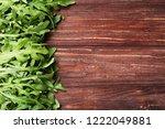 green arugula leafs on brown... | Shutterstock . vector #1222049881