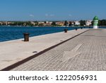 cobbled seafront with large... | Shutterstock . vector #1222056931