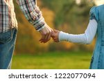 the parent holds the hand of a... | Shutterstock . vector #1222077094