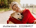 Stock photo pretty blonde with her beloved dog spending time together outdoor in the autumn nice portrait of a 1222084927