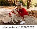 Stock photo fascinating blonde with adorable labrador spending day together in the autumn park touching photo 1222085077