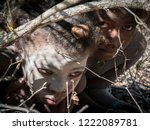 Small photo of Ambatomilo, Madagascar, Jul.31, 2018 - Girls of the Mikea nomads are afraid and hide in the forest, Madagascar