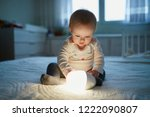 adorable baby girl playing with ... | Shutterstock . vector #1222090807