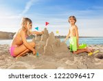 happy boy playing beach games... | Shutterstock . vector #1222096417