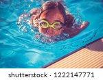 girl wearing swimming goggles... | Shutterstock . vector #1222147771