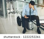 an asian businessman is sitting ... | Shutterstock . vector #1222252261