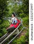 smiling teen girl riding...   Shutterstock . vector #1222272997