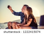 father and daughter relaxing on ... | Shutterstock . vector #1222415074