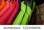 colorful t shirts on hangers | Shutterstock . vector #1222434034