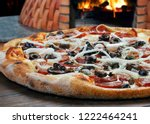 calabrese and corn pizza | Shutterstock . vector #1222464241