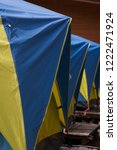 blue and yellow canvas tents in ... | Shutterstock . vector #1222471924