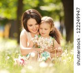 mother and daughter in the park | Shutterstock . vector #122249947
