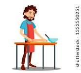 man cooking in the kitchen in... | Shutterstock .eps vector #1222550251
