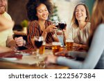 friends making a toast while... | Shutterstock . vector #1222567384