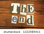 the end. letters cut from... | Shutterstock . vector #1222585411