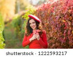 beautiful young woman in red... | Shutterstock . vector #1222593217