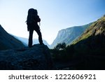 woman hiker stands with... | Shutterstock . vector #1222606921