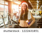 young woman in santa hat with... | Shutterstock . vector #1222631851