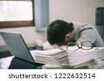 businessman asleep at office... | Shutterstock . vector #1222632514