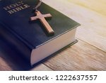 holy bible book and wooden cross | Shutterstock . vector #1222637557