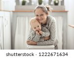 mom hugs baby son  daylight in... | Shutterstock . vector #1222671634