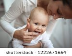 mom helps to brush the teeth of ... | Shutterstock . vector #1222671664