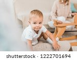 adorable toddler sitting and... | Shutterstock . vector #1222701694