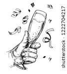 hand holding  glass with... | Shutterstock .eps vector #1222704217