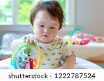little baby boy playing with... | Shutterstock . vector #1222787524