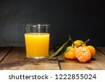 glass of orange juice and... | Shutterstock . vector #1222855024